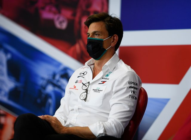 Mercedes team principal Toto Wolff speaks to the media