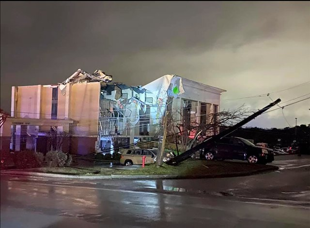 A Hampton Inn hotel is severely damaged