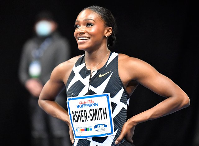 Dina Asher-Smith celebrates after winning the women's 60 metres final