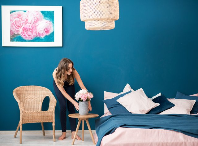 Woman arranging flowers in the bedroom