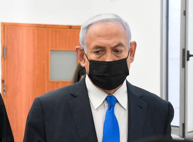Israeli Prime Minister Benjamin Netanyahu arrives for a hearing at the district court in Jerusalem