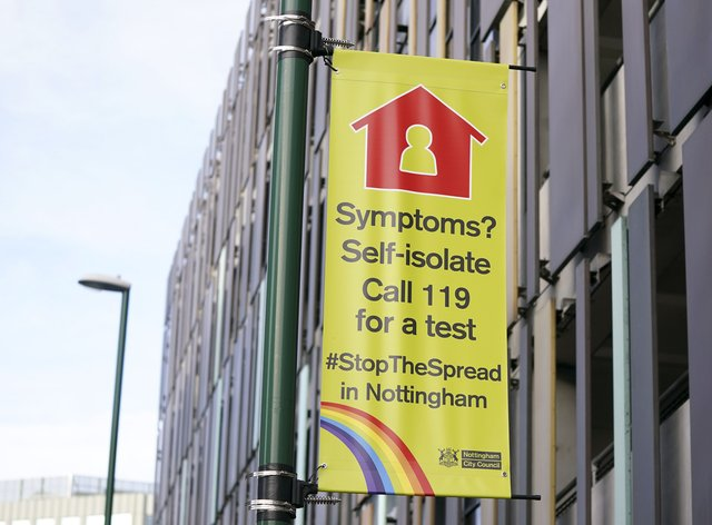 A sign telling people to self-isolate if they have Covid-19 symptoms