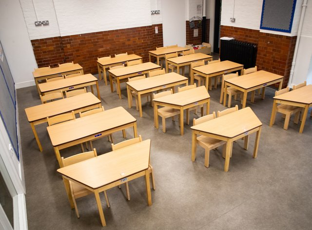 Tables and chairs spaced for social distancing in a classroom as The Charles Dickens primary school in London (Aaron Chown/PA)