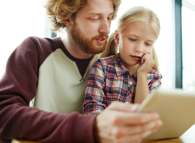 Dad and child learning