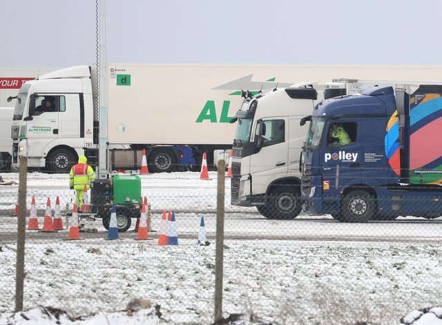 Lorry drivers wait to be tested for Covid-19 at Manston in Kent