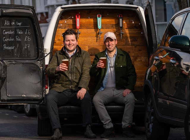 George Dean (left, a former bar manager and Finn Bruce, a video director with their Pub-on-wheels in Clapham, south London (Aaron Chown/PA)
