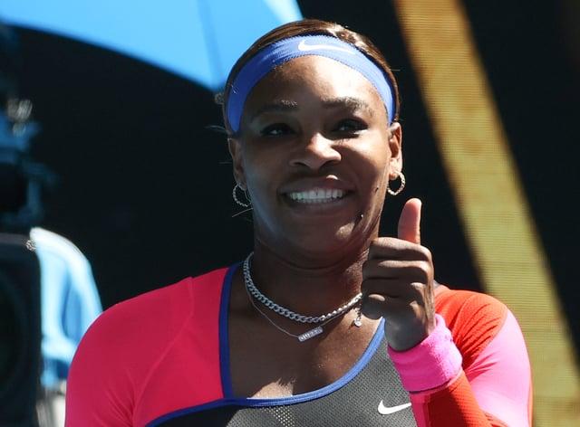Serena Williams gives a thumbs up after beating Aryna Sabalenka