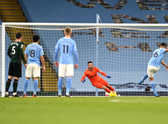 Manchester City's Rodri (right) opens the scoring against Tottenham from the penalty spot