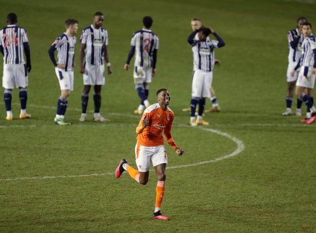 Blackpool defender Marvin Ekpiteta celebrates scoring against West Brom