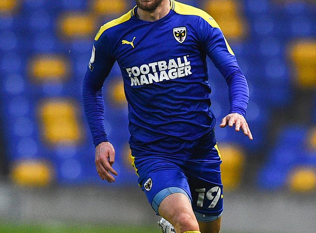 Shane McLoughlin could return to the fold for AFC Wimbledon against Gillingham after an injury