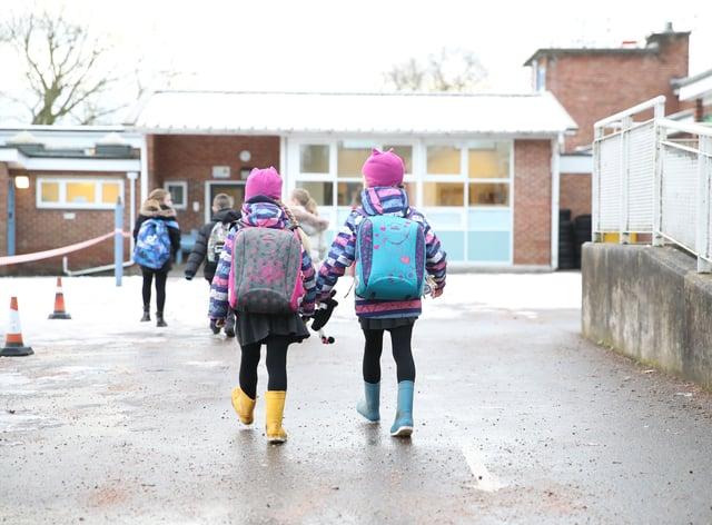 Pupils arrive at school