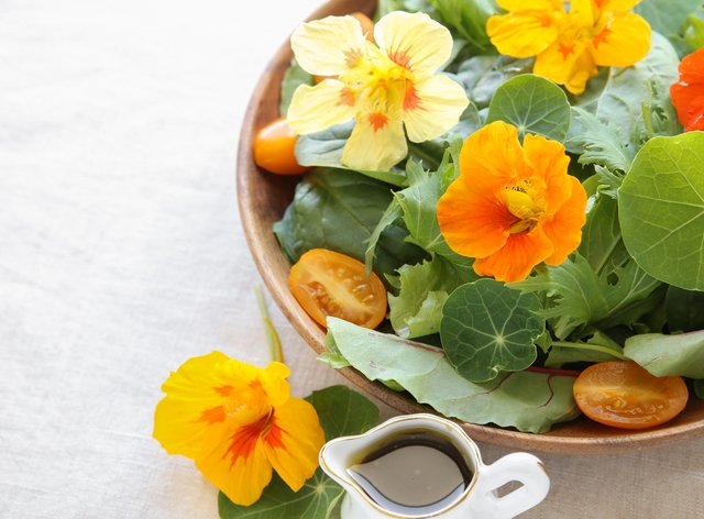 Fresh green salad with edible flowers (iStock/PA)