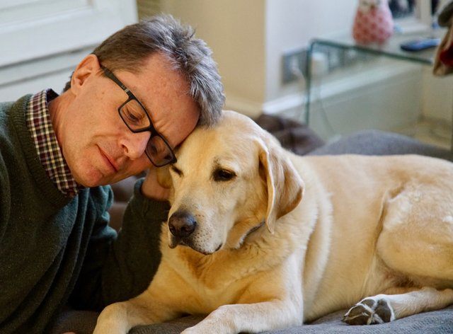 Nicky Campbell and his Labrador Maxwell (Nicky Campbell/PA)