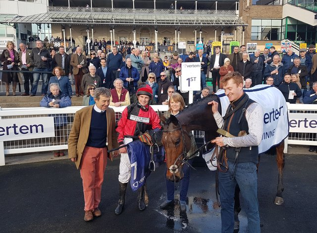 Winning trainer Caroline Bailey and jockey Jamie Moore pose with Crosspark after his win in the 2019 Eider Chase at Newcastle Racecourse