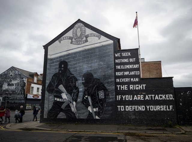 """Ulster Volunteer Force (UVF) mural in support the of Ulster loyalist paramilitary group, on the wall of a property on the Lower Newtownards Road in east Belfast. Paramilitarism remains a """"clear and present danger"""" in Northern Ireland, a new report has found. The Independent Reporting Commission (IRC) said it understands from police that there remains thousands of """"signed up"""" paramilitary members (Liam McBurney/AP)"""
