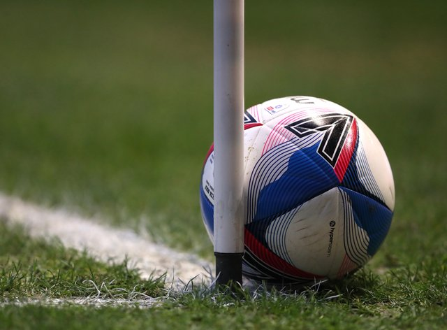 A general view of a match ball and corner flag post