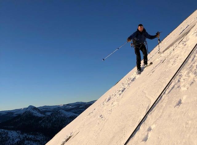 Zach Milligan is shown on his descent down Half Dome in Yosemite National Park, California