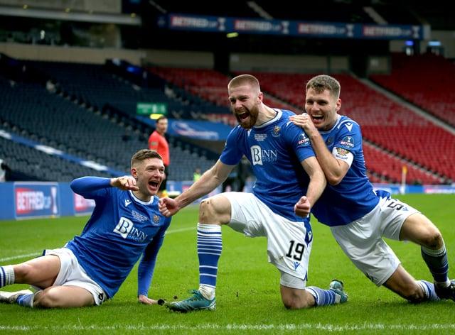 Shaun Rooney, centre, celebrates his goal
