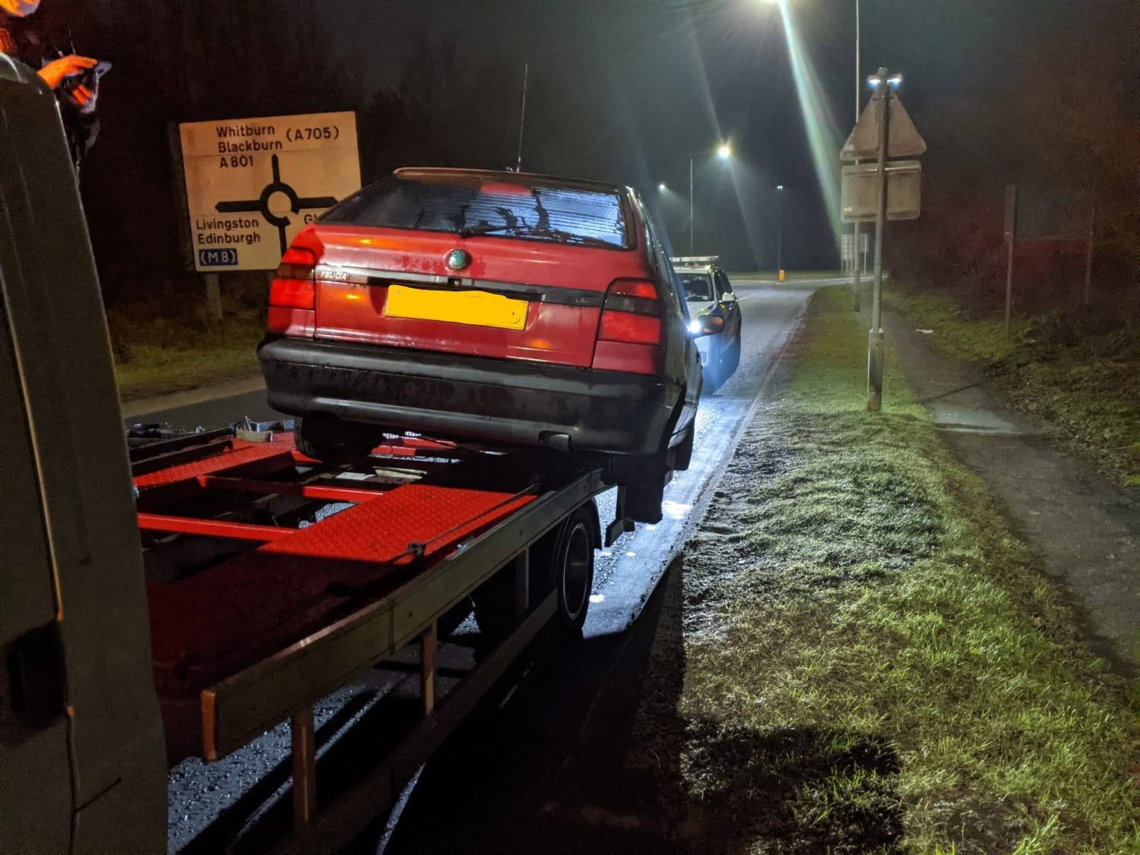 Recovery driver fined after police stop truck with car hanging off the side