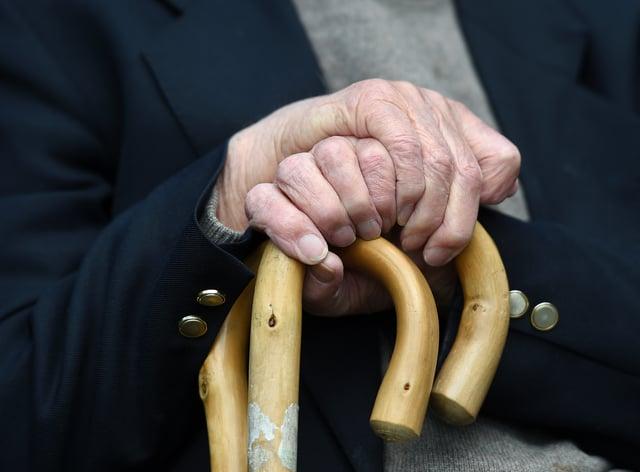 Elderly man with a walking stick