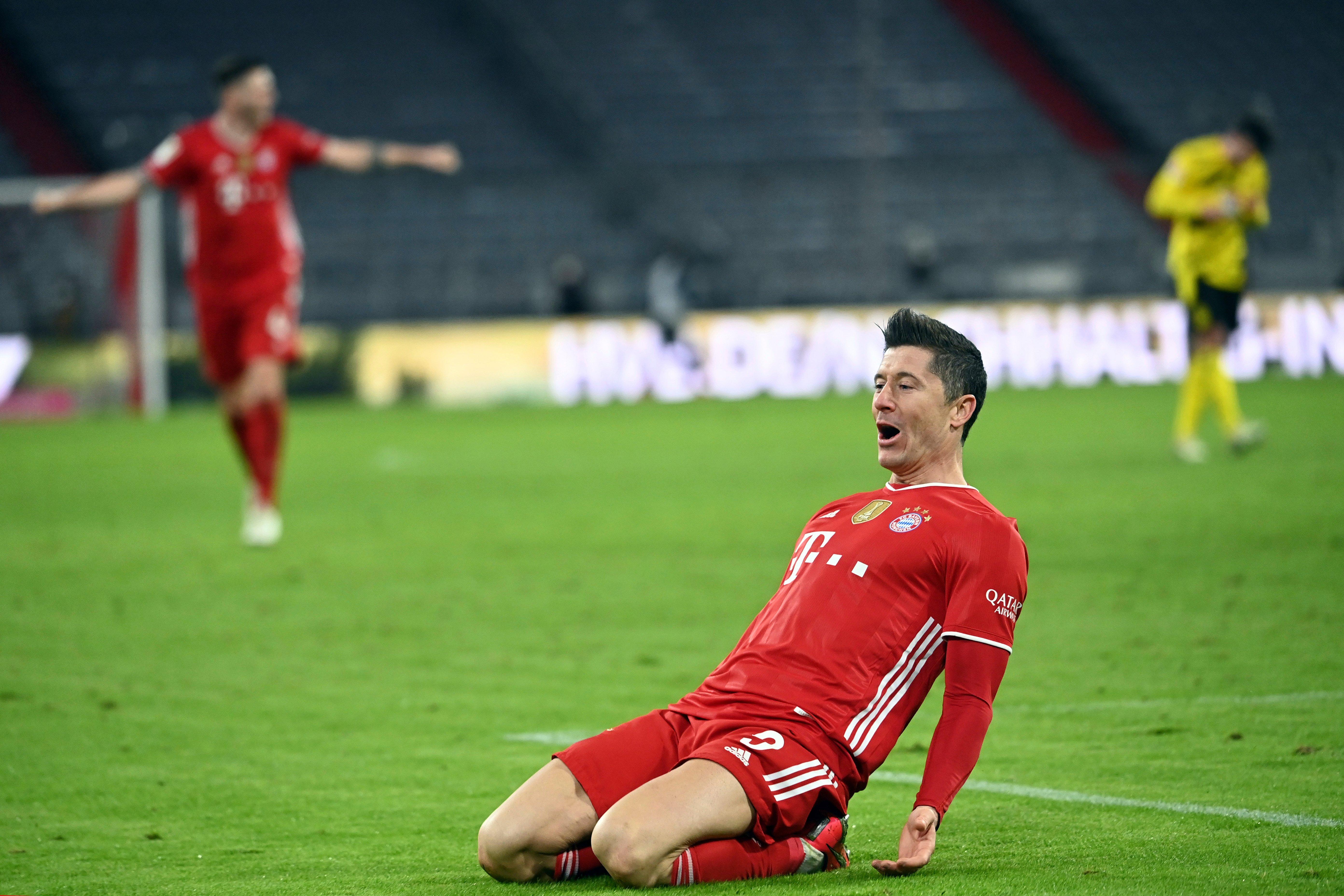 Robert Lewandowski hat-trick sees Bayern Munich fight back to beat Dortmund