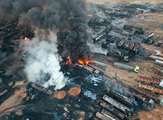 Burning oil tanker trucks in Syria
