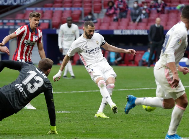 Karim Benzema, centre, helped Real Madrid claim a share of the spoils at Atletico