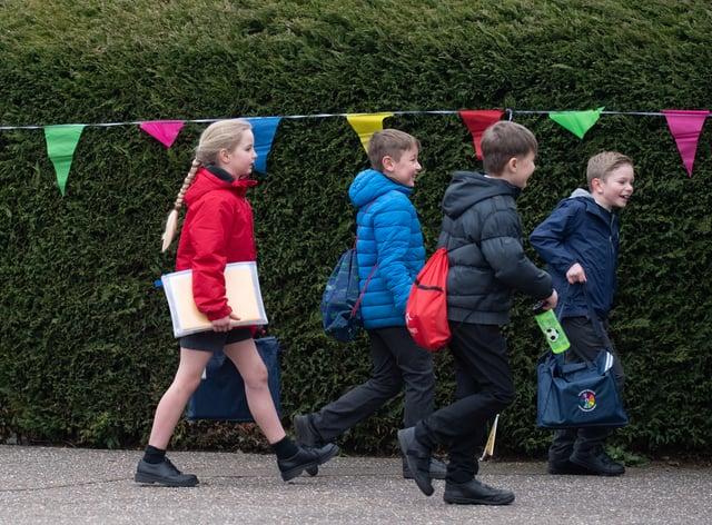 Children arrive at Thomas Bullock Church of England Academy in Shipdham, Norfolk