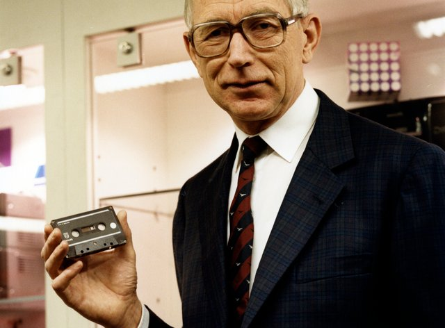 Structural engineer Lou Ottens holding an audio cassette poses for a photo in 1988 (Philips/AP)