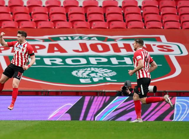 Lynden Gooch, left, celebrates Sunderland's winner