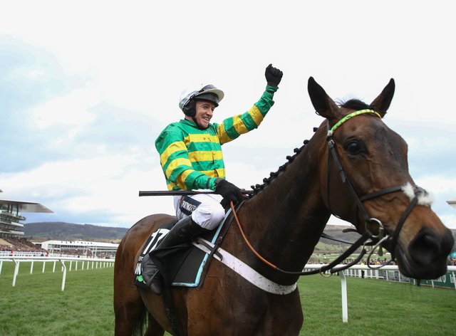 Barry Geraghty aboard Epatante following their victory in the Unibet Champion Hurdle Challenge Trophy on day one of the Cheltenham Festival at Cheltenham Racecourse, Cheltenham