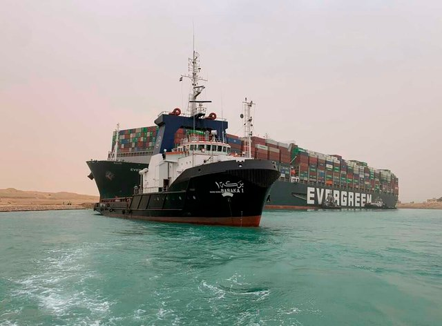 Suez Canal Authority boats come to the assistance of the Ever Given on Wednesday
