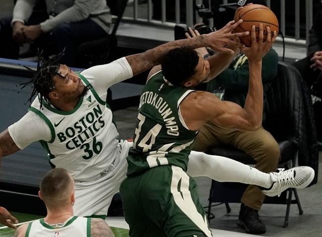 Boston Celtics' Marcus Smart fouls Milwaukee Bucks' Giannis Antetokounmpo