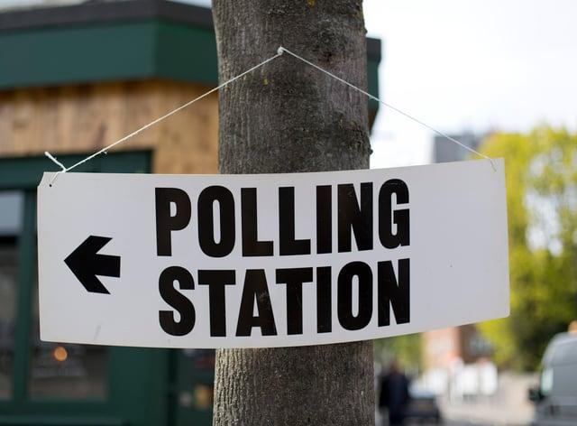 A polling station sign (Yui Mok/PA)