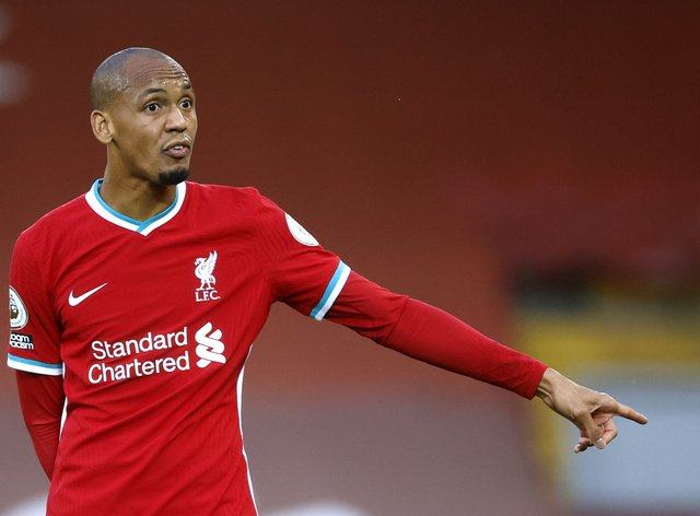 Liverpool midfielder Fabinho points while on the pitch
