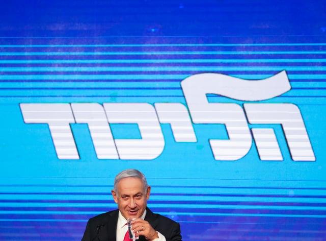 Israeli prime minister Benjamin Netanyahu drinks water (Ariel Schalit/AP)