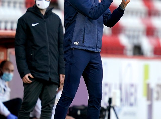 Stevenage manager Alex Revell gestures on the touchline
