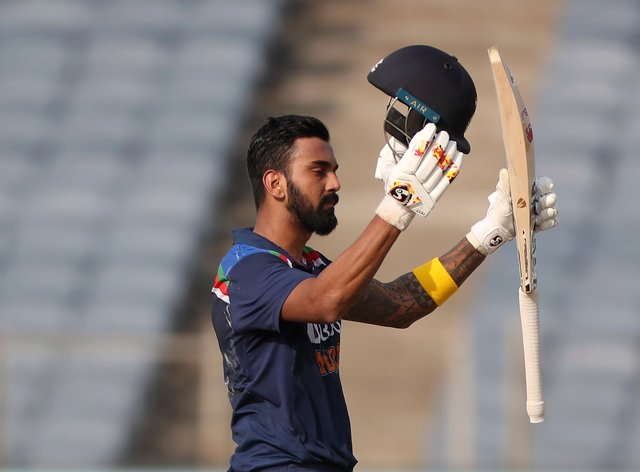 India's KL Rahul celebrates scoring a century during the second ODI against England in Pune