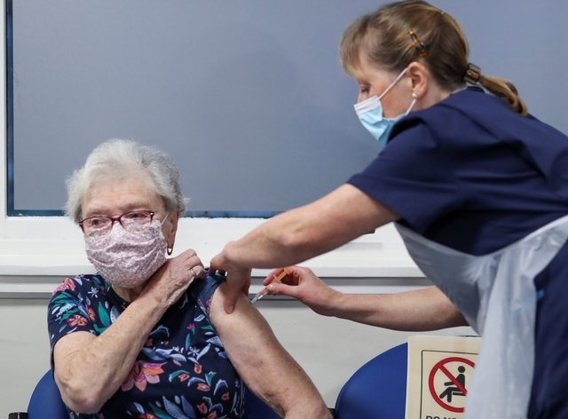 Woman receives vaccine