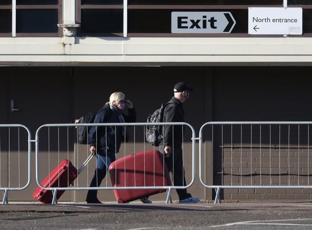 Coronavirus travellers at an airport