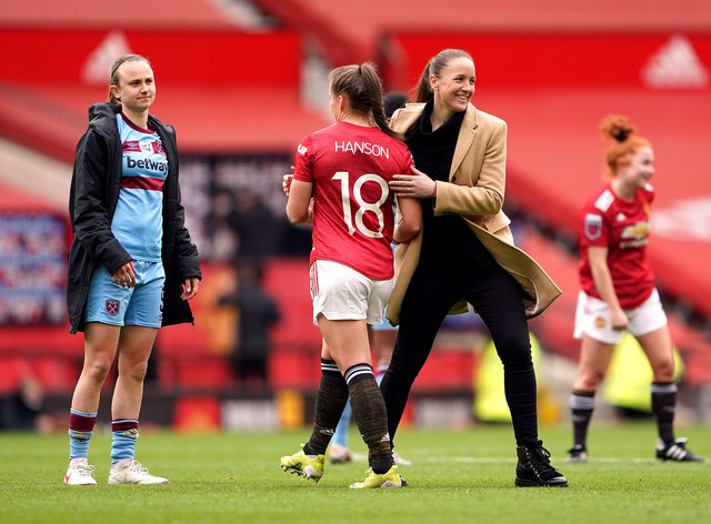 Casey Stoney congratulates her players after Manchester United Women's first match at Old Trafford