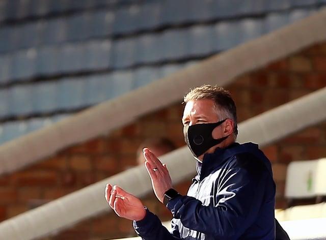Peterborough manager Darren Ferguson applauds from the stands