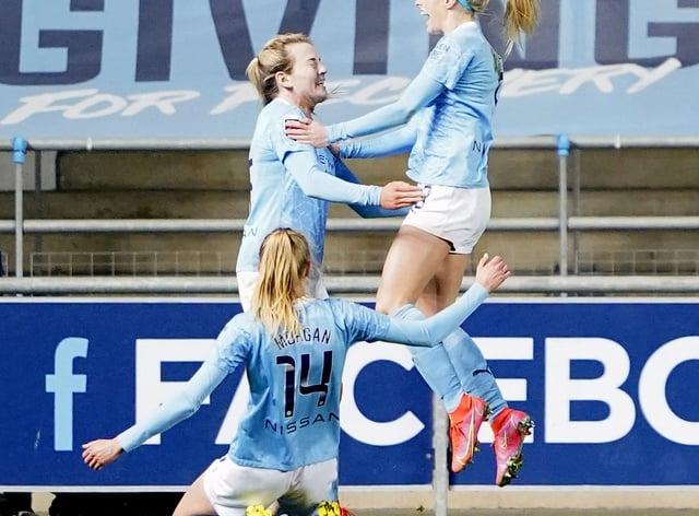 Manchester City's Chloe Kelly (right) celebrates her winning goal