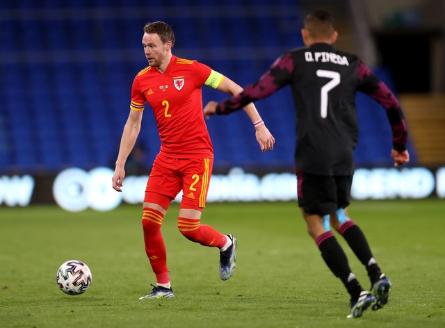Chris Gunter (left) won his 100th cap for Wales against Mexico