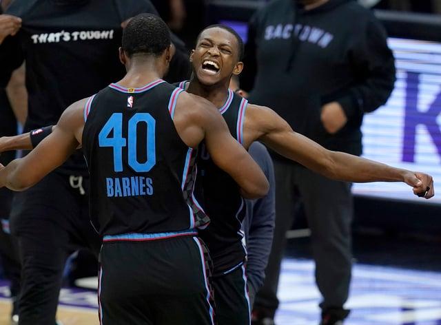 Sacramento Kings forward Harrison Barnes is congratulated by guard De'Aaron Fox