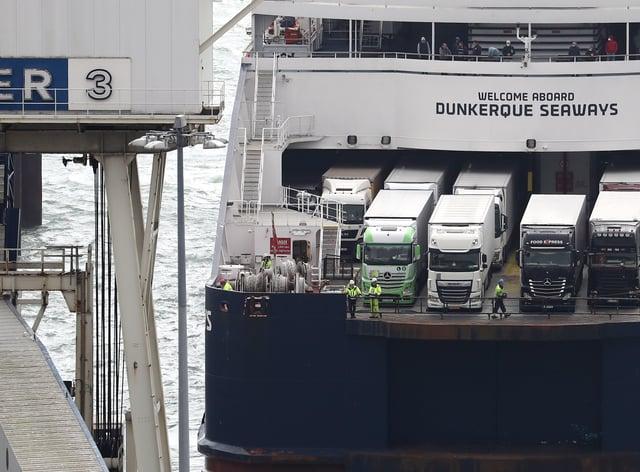 Lorries arrive in Dover, Kent, onboard a ferry