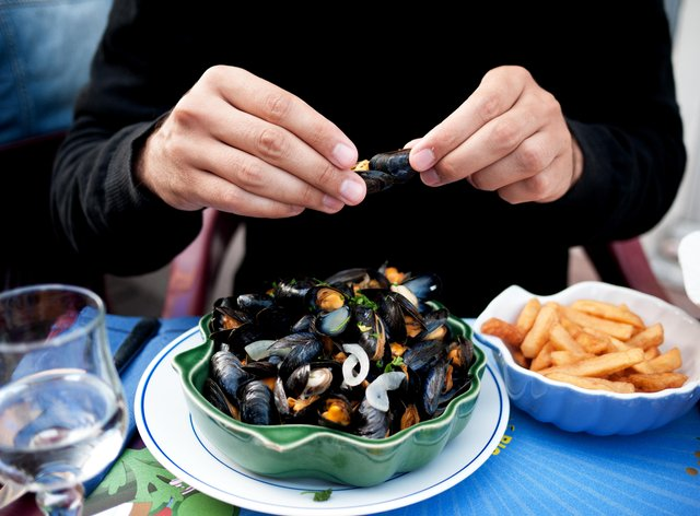 Man eating mussels