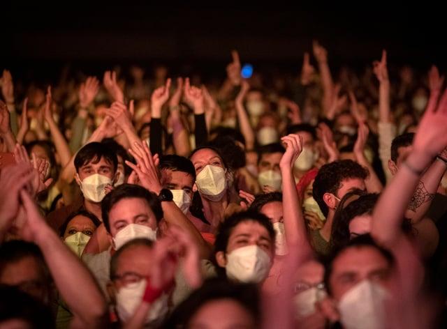 Revellers enjoy a music concert in Barcelona, Spain