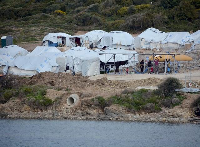 Migrants gather outside their tents at Karatepe refugee camp, on the eastern Aegean island of Lesbos, Greece (Panagiotis Balaskas/AP)
