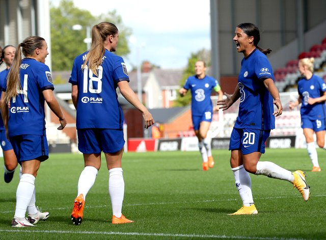 Sam Kerr (right) and Fran Kirby (left) celebrate a goal